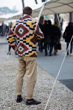 Photographer and blogger, The Sartorialist shot the Intarsia shawl collar cardigan from the Fall 2012 Denim & Supply Ralph Lauren Collection for his feature: On the Street... Graphics, Florence