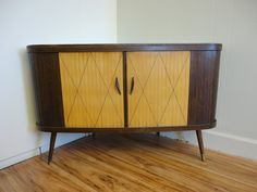 RESERVED - Mid Century Revolving Bar and Bookcase Vintage Tiki. $700.00, via Etsy.