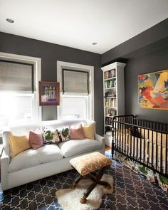 I WANT THIS COUCH! So many things about this nursery are to die for. Standouts for us are the charcoal grey walls, the rug, and the window treatments. But the most interesting choice in the nursery is the use of a couch in place of a rocker or glider. Sophisticated Nursery, Bebe Love, Nursery Inspiration, Nursery Ideas, Nursery Themes, Nursery Neutral, Nursery Gray, Neutral Nurseries, Nursery Design