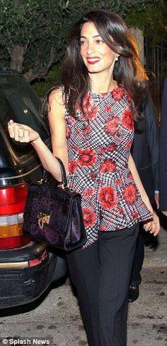 Amal in Greece wearing Oscar de la Renta.