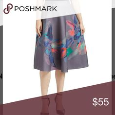 COMING SOON! Grey Brushstroke Floral A Line Skirt Bring a touch of flair to your wardrobe with this curve accentuating skirt for work or a night on the town! 28in long. 95%polyester, 5% spandex. Sz L fits 12/14 waist 29-31 and hip 32-34. Sz XL fits sz 16 waist 32 and hip 35.  From Nancy Yang. Skirts A-Line or Full