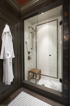 Subway tile shower with marble mosaic accents.