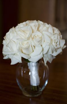 White and Yellow round rose bouquets, light tinted greens- we will transfer them in little vases or plastic containers like this. Need to have stems in water at all times. Ill add ribbon afternoon of. Don't want splashy water to make ribbon wet.