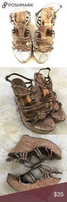 Bronze Fergie Wedges These snake print wedges are a must have for summer.Bronze color with black snake print strappy wedges.Super Cute and in Excellent like new condition Fergie Shoes Wedges