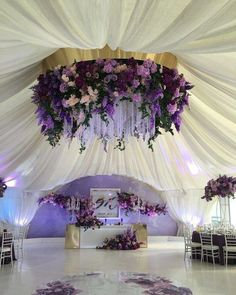 2019 Brides Favorite Purple Wedding Colors---hanging chandelier with lush flowers decorations under the white drapery Wedding Reception Decorations, Wedding Themes, Wedding Designs, Wedding Colors, Wedding Flowers, Wedding Dresses, Wedding Ideas, Reception Ideas, Party Ceiling Decorations