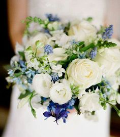 Blue-Violet Delphinium, Blue Tweedia, Blue Muscari Hyacinth, White Stephanotis, White Roses, White Lisianthus, White Delphinium, Greenery Wedding Bouquet