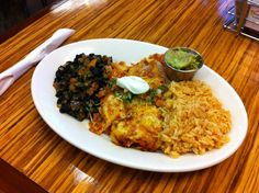 Chicken enchiladas (3) with Spanish rice and black beans
