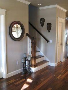 Grey wall dark floors