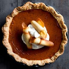 Bourbon Pumpkin Pie with Nutmeg Tuiles | For this pie, we added a shot of whiskey to the filling and dressed up the pie by accompanying it with thin, crisp cookies.