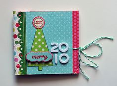 Good binding idea - http://www.acherryontop.com/articles/Christmas-Mini-Album-12260