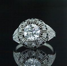 Google Image Result for http://www.langantiques.com/images/external/10/1231968957_Art_Deco_2.02_Carat_Diamond_Ring_Main_View10-1-1908.jpg