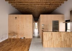 Wooden boxes define rooms and mezzanines in Loft House by CAPD