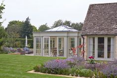 David Salisbury Orangery Extension In a Cotswold Village. House Extension Plans, Orangery Extension, Cotswold Villages, Roof Lantern, Timber Windows, Lean To, Coach House, English House, Outdoor Swimming Pool