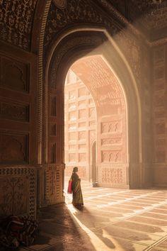 A woman near a doorway at the Taj Mahal in Agra, India.