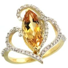 14k Gold ( 14x7 mm ) Stone Engagement Citrine Ring w/ 0.33 Carat Brilliant Cut Diamonds & 2.30 Carats Marquise Cut Stone, size 9; Amazon description: This Beautiful Ring is crafted from Solid 14 Karat Gold and set with Genuine Diamonds & Precious Gem. The Quality is Outstanding and yet the Price is Very Reasona...