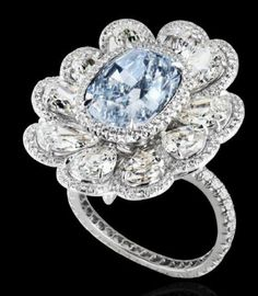 Fancy Blue And White Diamond Ring - carat fancy light blue diamond accented by 10 pear-shaped diamonds mounted on platinum. fancy light blue diamond accented by 10 pear-shaped diamonds mounted on platinum. White Diamond Ring, Pear Shaped Diamond, Diamond Rings, Diamond Jewelry, Diamond Engagement Rings, Jewelry Rings, Gemstone Rings, Fine Jewelry, Jewelry Drawer