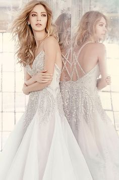 Orchid tulle modified A-line bridal gown, rhinestone-encrusted beadwork throughout with alabaster and hologram accent, sweetheart neckline and beaded straps, full skirt with tulle godets. Hayley Paige Spring 2016 Wedding Dress Collection