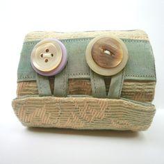 Wrist cuff wallet w/buttons