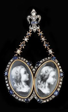 A late 19th century French sapphire and diamond double portrait locket. The oval panels with miniature portraits probably of Louis-Charles, Dauphin of France, the reverses engraved with the Dauphin's crown above a fleur-de-lis, within a lasque cut diamond and pinched collet set sapphire surround, suspended from diamond and sapphire set shaped panels, from a sapphire and diamond set fleur-de-lis slide surmount, stamped with French poincons, 8.6cm long.