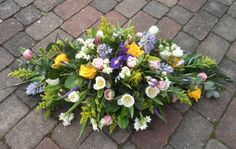 Ideal for a person who enjoyed their garden, this tribute of spring flowers includes tulips, daffodils, hyacinths and iris, other seasonal flowers can be used throughout the year.