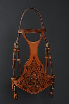 Hand tooled bridle by French saddler Jean-Luc Parisot, Parisotsellier.com