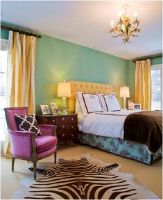 mint walls, yellow drapes and upholstery, fuchsia chair. Zebra accents. Love the fun fresh color scheme! By Marmalade Interiors