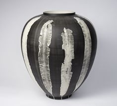 The Silverware collection of vases (2012), by Anglo-Dutch designers Studio Glithero. Seaweed has left its mark on the photosensitive surfaces of these vases.