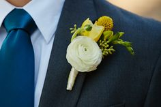 White Ranunculus and Yellow Billy Ball Boutonniere