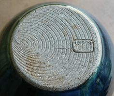 Cley Pottery, Norfolk  Idea: make your pottery signature like a stamp or carved into the bottom of the wheel so you don't have to ruin the clay tryin to inscribe your signature into it.