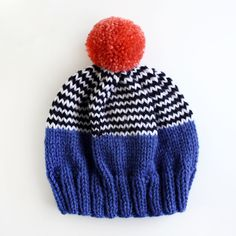 Hand-knit from soft 100% acrylic in playful colorblock