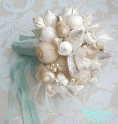 For the beach-loving bride, shells make a beautiful arrangement. You can assemble your own, or find them for sale on Etsy.