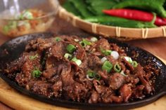 """Korean """"barbecued"""" beef. Bulgogi and kimchi fried rice (kimchi bokkeumbap). Put this in a soft taco shell and never eat """"regular"""" tacos again!"""