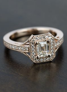 We can't get enough of this beautiful Vintage Milgrain Halo Emerald Diamond Engagement Ring in Rose Gold!