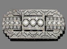 A diamond brooch.  The rectangular plaque of pierced geometric design, millegrain-set throughout with brilliant and rose-cut diamonds, brilliant-cut diamonds approx. 1.25cts total, length 5.8cm. Edwardian or Edwardian style.