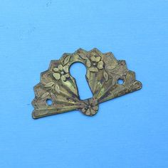 Antique Vintage Brass Keyhole Key Hole Cover Escutcheon Steampunk Jewelry Ornate DIY Jewelry Keyhole Cover. $7.00, via Etsy.