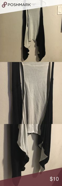 Black and white asymmetrical open vest Super cool, but too big. White inside, black outside but both colors show when worn. Never been worn. Jackets & Coats Vests