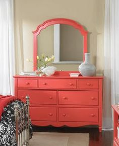 ok so this is originally from decorsouth.com - but the specific linked page no longer exists... so you'll have to take inspiration from the picture alone... coral dresser - i think i would love this more in a turquoise with an unattached mirror... but i love the idea of an unexpected splash of color!!! or maybe just a distressed turqouise entry way table... hmmmm
