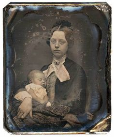 1840s mother with her deceased baby. The pain in the mother's eyes is obvious in this post mortem.