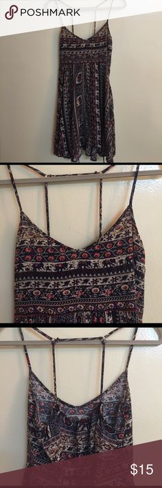 COZY Casual Boho Sundress Elephant Motif This hot little strappy dress is cool. It has great Cotton fabric and  thin adjustable straps. Has hi lo hem and swingy skirt. It is in perfect condition and ready to wear. COZY Dresses