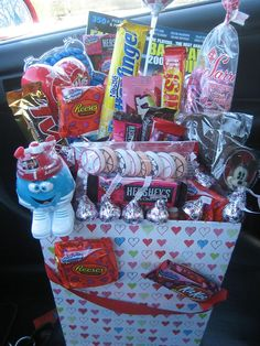 Candy basket for Valentines Day!  Use skewers to hold candy in place.  Use foam in the bottom to hold the skewers.  Use toothpicks for smaller candy.