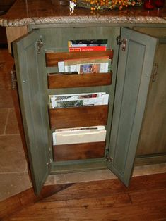 "This mail cabinet is only 2.5"" deep, and with the doors closed it's only 1.75"" deep. The wood file boxes were custom built for this space. Keeping mail in a place where it can be retrieved but not left on the counters."