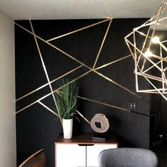 The geo lines dressed the accent walls. Fabricut Muse Arabica is the black wallpaper, then gold foil Mylar tape is the free form design… Glitter Accent Wall, Black Accent Walls, Black Walls, Gold Accent Wallpaper, Black Wallpaper Bedroom, Gold Accent Decor, Black Gold Bedroom, Gold Wall Decor, Art Deco Bedroom