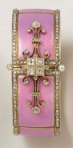 AN ANTIQUE ENAMEL AND DIAMOND BANGLE BRACELET. Of articulated design, the pink opalescent guilloché enamel panels with rose-cut diamond borders, joined by a central old European-cut diamond four-stone plaque, flanked on either side by scrolled knife-edge detail, enhanced by rose-cut diamonds, mounted in 18k gold, circa 1880, with French assay marks and maker's marks. #Antique #BelleEpoque #bracelet