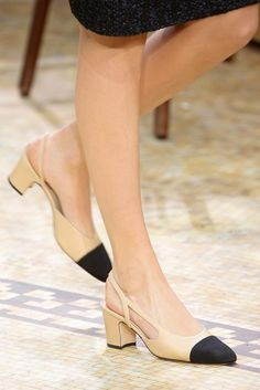 At the Fall 2015 Chanel Fashion Show, Karl Lagerfeld showed 93 fall looks and they were all shown with the same shoe: the beige and black capped toe slingback shown above. Slingback Shoes, Pump Shoes, Shoe Boots, Shoes Heels, Chanel Slingbacks, Cc Shoes, Louboutin Shoes, Platform Shoes, Converse Shoes
