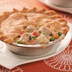 Make-Ahead Turkey Potpie Recipe -Some days, your cravings don't jive with your busy schedule. Problem solved! Whip up a batch of these rich, creamy potpies, and enjoy two tonight and tuck two in the freezer for another time. They take less than 30 minutes to prepare, and freeze beautifully. What's even better is the filling lends itself to variation. You can use what you already have on hand, even leftovers! —Taste of Home Test Kitchen