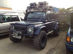 Land Rover, off roading, wheels, expedition, trail blazing, power, engine, grit, gears, axles, all wheel drive, mud, dirt, sand, water, KC lights, head lamps, spare tire, 4x4