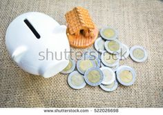 piggy bank with coin and home on old wood.concept save money