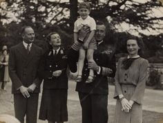 The Duke and Duchess of Gloucester with Lord and Lady Mountbatten, who hold a young Prince William.