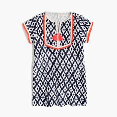 "A comfy terry cloth dress with a fun batik print (and cute contrasting tassels!) pretty much has ""spring"" and ""break"" written all over it. <ul><li>Falls above knee.</li><li>Cotton/poly.</li><li>Machine wash.</li><li>Import.</li><li>Sizes 2 and 3 do not have ball trim piping.</li></ul>"