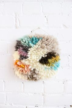 Such a cute shaggy wall hanging! From Baba Souk